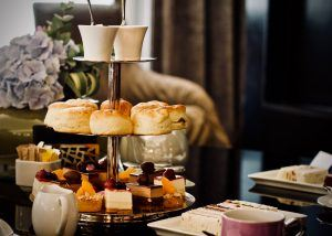 afternoon tea with scones, cakes and sandwiches