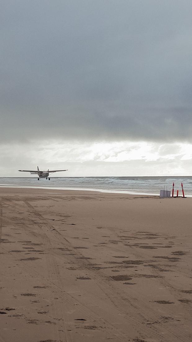 plane landing on 75mile beach